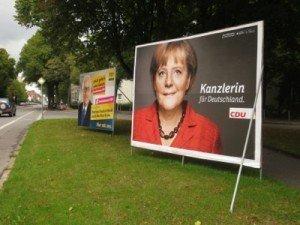 Plakate mit Rainer Brüderle und Angela Merkel in Aachen. Foto: OD